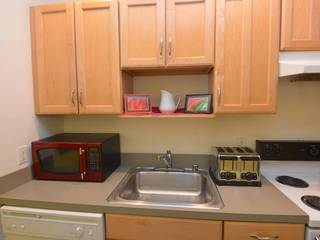 Fully equipped kitchen with microwave, toaster, dishwasher, pots and pans