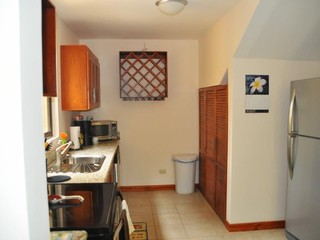 Kitchen with stainless steel appliances and full-size washer/dryer