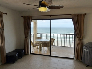 Living Room with Direct Oceanfront view from Large Private Balcony