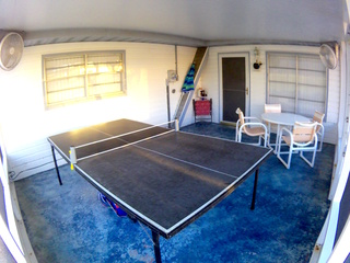 Enjoy Bug-Free dining and Ping Pong in the Screened Lanai